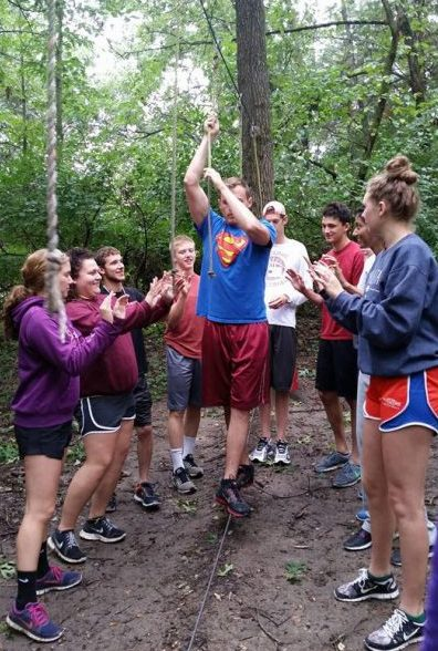 2016-17 cohort members build on their teamwork skills while on the low ropes course at the fall leadership retreat.