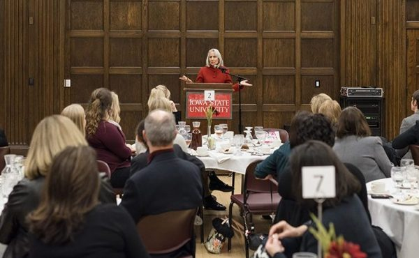 Lynn Povich answers a question during a private dinner before her public lecture.