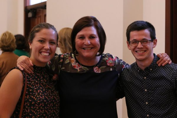 Bystrom poses with Catt Center students Zoey Shipley and Cody Woodruff at the reception.