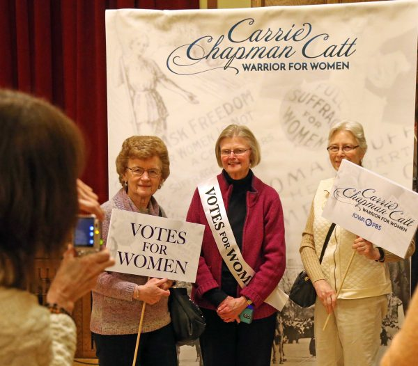 "Attendees get their picture taken before the screening of the Iowa PBS documentary ""Carrie Chapman Catt: Woman Warrior."""