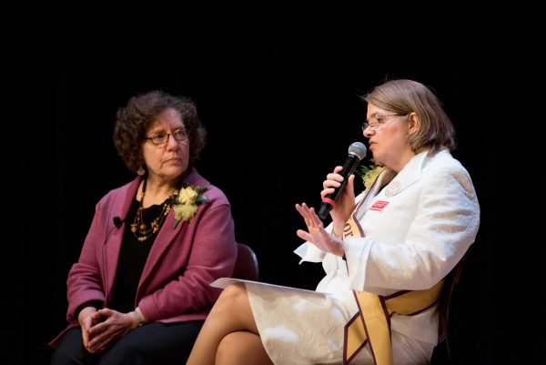 Elaine Weiss (left) answers questions in a question and answer session moderated by center director Karen Kedrowski (right).